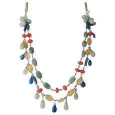 Gemstone necklace in bright blue, yellow orange and green colors of the Southwest