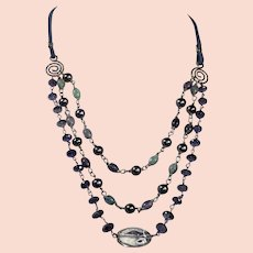 Iolite blue gemstone necklace with crystal focal