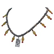 Southwest style cultured pearl necklace with Zia sun pendant