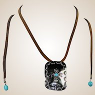 "Native American, Navajo, sterling silver ""conch"" style pendant with American Turquoise"
