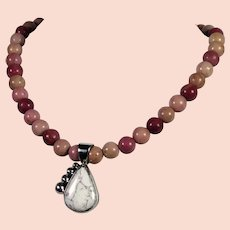 Native American, Navajo, sterling silver and Howlite pendent on a Rhodonite bead necklace