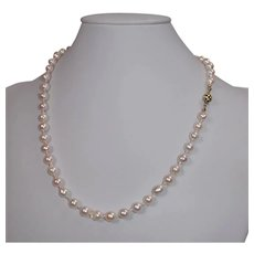 Japanese salt water cultured pearl necklace with a 14 K solid gold clasp