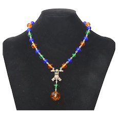 Multi colored glass bead necklace with a Topaz glass pendant