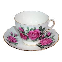 Teacup and saucer with pink roses from the mid century