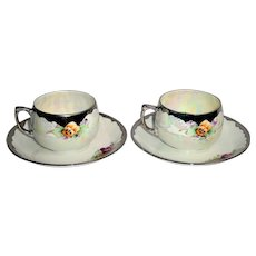 German porcelain teacup and saucer set signed by T Jorgensen