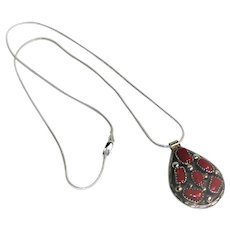 Signed Rhoda Jack, Navajo, sterling silver and blood coral pendant