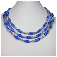 "Contemporary multi strand necklace made with ""Cherry Brand"" blue glass beads"