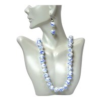 Vintage Cherry Brand white milk glass beads with blue abstract design