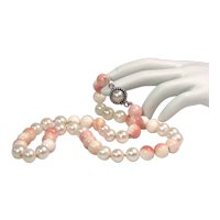 Freshwater pearl necklace with pink conch shell beads