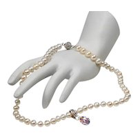 Freshwater cultured pearl necklace with a Swarovski crystal pendant