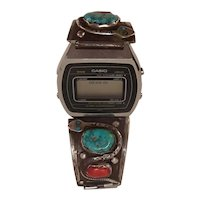 Effie Calavaza Zuni Turquoise Coral and Snake Sterling Watch Band.