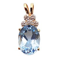 14 karat Yellow Gold Oval Blue Topaz and Diamonds Pendant