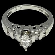 Platinum Diamond Engagement Ring with Marquise, Baguettes, and Round Diamonds