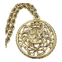 Coro Round Crest Pendant Necklace in Gold Tone