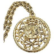 Coro Round Crest Pendant Necklace in Gold Tone