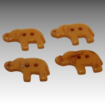 Set of 4 Carved Bakelite Elephant Buttons