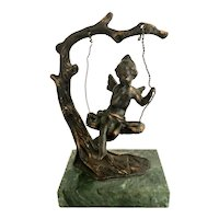Vintage Bronze Cherub on a Tree Swing