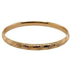 14K Gold Bangle With a Swirl Design
