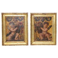 Matching Pair of Italian School 19th Century Amorini w/ Baskets of Flowers