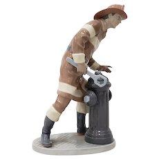 "Lladro ""The Fireman"" Porcelain Figurine No. 5976 Circa 1990s"