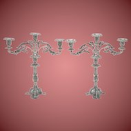 Pair of Portugese Cast silver candelabra