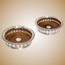 A Pair of Late George III Silver Wine Coasters