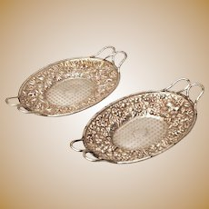 Pair of A.E Warner Coin Silver Repousse Fruit Baskets