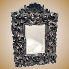 Silver Decorative Mirror With Cherubs