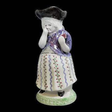 A Rare Toby Jug Depicting a Woman Taking Snuff, circa 1820