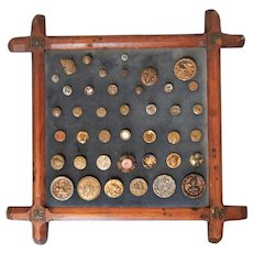 Collection of Antique Buttons Mounted on a 19th Century Wood Frame