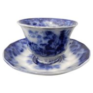 Flow Blue Handleless Cup with Saucer in the Sobraon Pattern