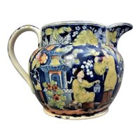 "A Rare ""Lady with Bird and Cage"" Pattern Filled-In Pearlware Transferware Jug, Circa 1825."