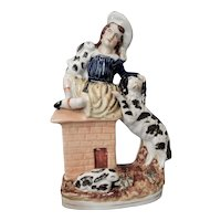 Staffordshire Figure of a Girl with Rabbits and a Dog