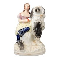 A Charming Staffordshire Girl and Dog Figure