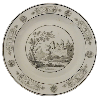 A French Faience Transferware plate with a Classical Ruins Scene