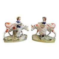 A Wonderful Pair of Staffordshire Children with Cows, circa 1870.