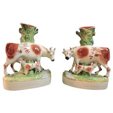 A Large Pair of Staffordshire Cow and Calf Spill Vases, circa 1870