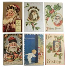 Six Vintage/Antique Christmas Postcards Featuring Santa Claus, circa early 20th century