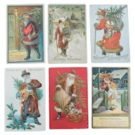 Six Early 20th Century Santa Claus Themed Postcards