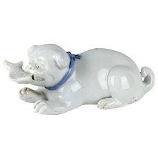 Japanese Hirado Porcelain Figure of a Puppy with a Fish