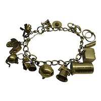 Fantastic Original Solid 14kt. (marked and tested) 1940's Multi moveable Charm Bracelet...13 rare unique charms