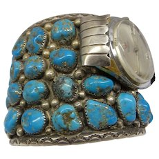 Very Wide and Heavy Old Sterling Native American Cuff Watch Bracelet with Many Rare Natural Turquoise.