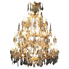 Old nice French chandelier in Louis XVI style