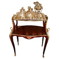 Elegant tea table with bronze decorations in French style