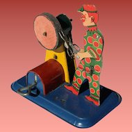 Ferdinand Strauss Tin Litho Wind Up  Toy Scissor Sharpener