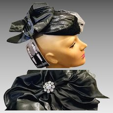 UNUSED w/Orig 100.00 Tag Vintage WHITTALL & JAVITS Metallic black/silver derby party Hat - 19""