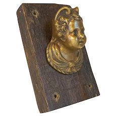 Small French Ormolu Bronze Cherub Mask Furniture Mount on Wood Panel