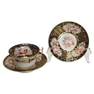 English Soft Paste Porcelain Tea Cup and 2 Saucers