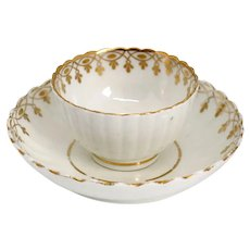 English Caughley Gilt Soft Paste Porcelain Fluted Tea Bowl and Saucer