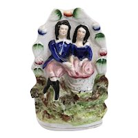 English Staffordshire Pottery Flatback Figural Group of a Courting Couple